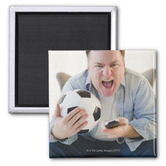 USA, Jersey City, New Jersey, man holding remote Magnet