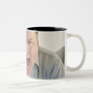 USA, Jersey City, New Jersey, man holding remote Two-Tone Mug