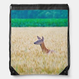 USA, Kansas, White Tail Doe Crossing Wheat Drawstring Bag