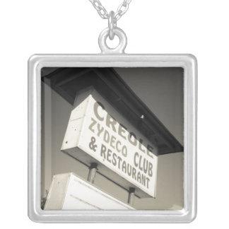 USA, Louisiana, Henderson. Creole Zydeco Music Square Pendant Necklace