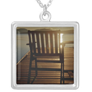 USA, Maine, Rockwood. A chair with a view of Silver Plated Necklace