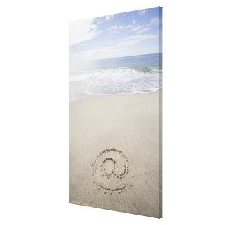 USA, Massachusetts, At sign drawn on sandy beach