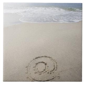 USA, Massachusetts, At sign drawn on sandy beach Tile