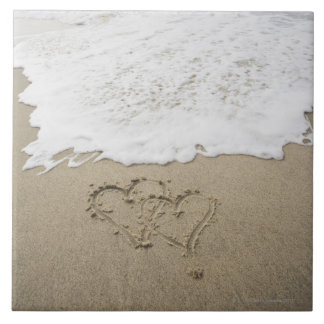 USA, Massachusetts, Hearts drawn on sandy beach 3 Tile