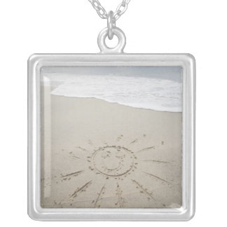 USA, Massachusetts, Sun drawn on sandy beach Silver Plated Necklace