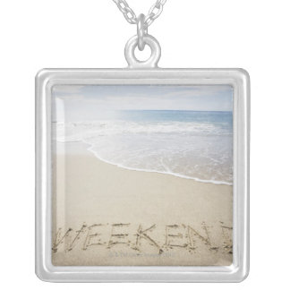 USA, Massachusetts, Word ''weekend'' drawn on Silver Plated Necklace