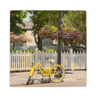USA, Michigan, Mackinac Island. Yellow Bike Wood Coaster