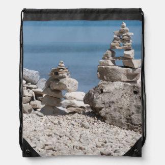 USA, Michigan. Stone Towers On The Beach Drawstring Bag