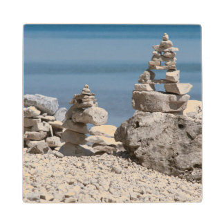 USA, Michigan. Stone Towers On The Beach Wood Coaster
