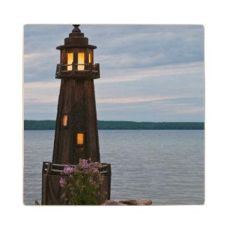 USA, Michigan. Yard Decoration Lighthouse Wood Coaster