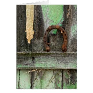 USA, Montana. Rusty horseshoe on old fence Card