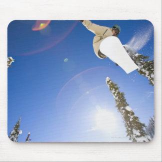 USA, Montana, Whitefish, Young man snowboarding Mouse Mat