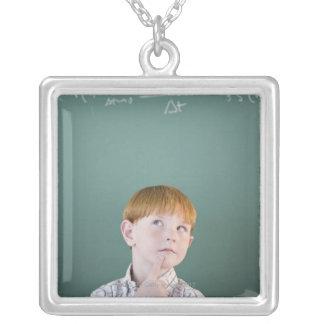 USA, New Jersey, Jersey City, Boy (8-9) Silver Plated Necklace