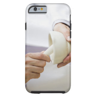 USA, New Jersey, Jersey City, Doctor preparing Tough iPhone 6 Case