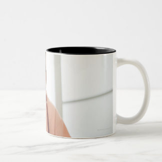 USA, New Jersey, Jersey City, female nurse Two-Tone Coffee Mug