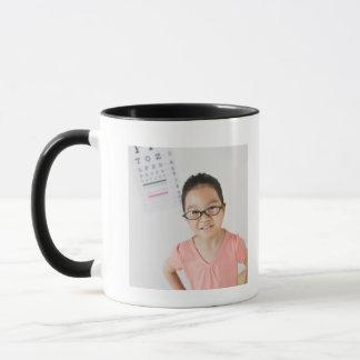 USA, New Jersey, Jersey City, Girl (6-7) at eye Mug