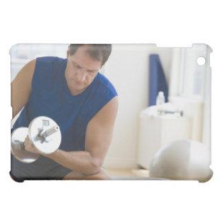 USA, New Jersey, Jersey City, Mature man lifting iPad Mini Covers