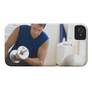 USA, New Jersey, Jersey City, Mature man lifting iPhone 4 Case