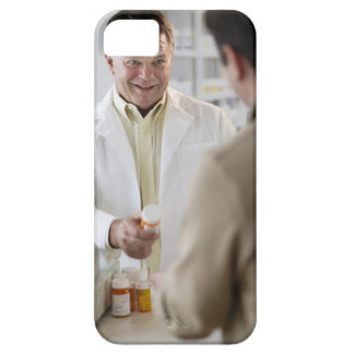 USA, New Jersey, Jersey City, Pharmacist selling Barely There iPhone 5 Case