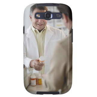 USA, New Jersey, Jersey City, Pharmacist selling Samsung Galaxy S3 Cover