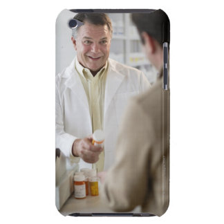 USA, New Jersey, Jersey City, Pharmacist selling iPod Case-Mate Cases