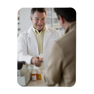USA, New Jersey, Jersey City, Pharmacist selling Magnet