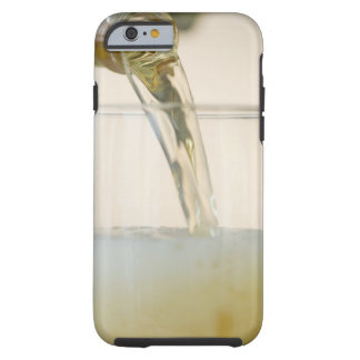 USA, New Jersey, Jersey City, pouring beer into Tough iPhone 6 Case