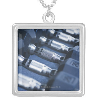 USA, New Jersey, Jersey City, Row of dumbbells Square Pendant Necklace