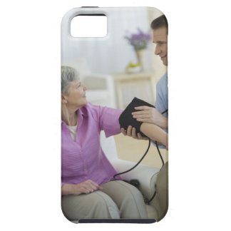 USA, New Jersey, Jersey City, Smiling man taking iPhone 5 Covers