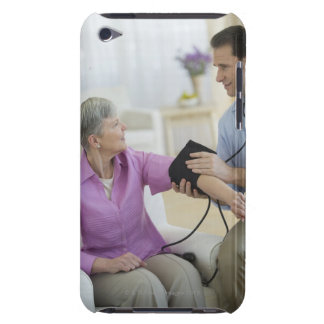 USA, New Jersey, Jersey City, Smiling man taking iPod Touch Case