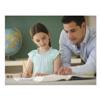 USA, New Jersey, Jersey City, teacher helping Postcards