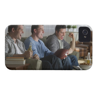 USA, New Jersey, Jersey City, three men watching 2 Case-Mate iPhone 4 Cases