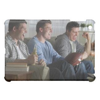 USA, New Jersey, Jersey City, three men watching 2 iPad Mini Cases