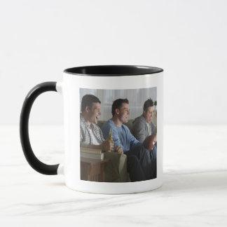 USA, New Jersey, Jersey City, three men watching 2 Mug