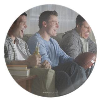 USA, New Jersey, Jersey City, three men watching 2 Plate