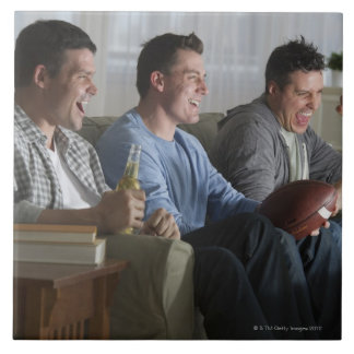 USA, New Jersey, Jersey City, three men watching 2 Tile