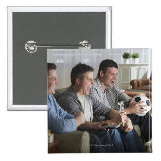 USA, New Jersey, Jersey City, three men watching 15 Cm Square Badge