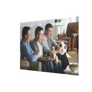 USA, New Jersey, Jersey City, three men watching Canvas Print