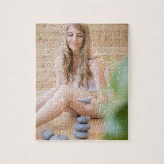 USA, New Jersey, Jersey City, Woman arranging Jigsaw Puzzle