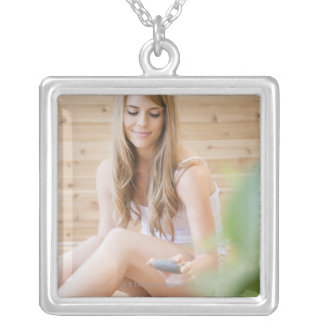 USA, New Jersey, Jersey City, Woman arranging Silver Plated Necklace