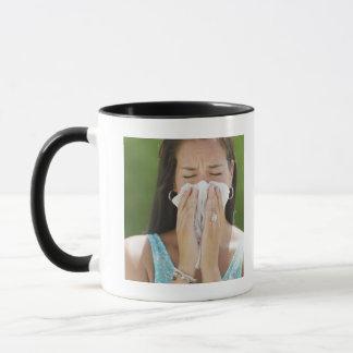 USA, New Jersey, Jersey City, Woman blowing nose Mug
