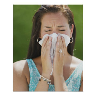 USA, New Jersey, Jersey City, Woman blowing nose Poster