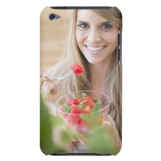 USA, New Jersey, Jersey City, Woman eating iPod Touch Covers