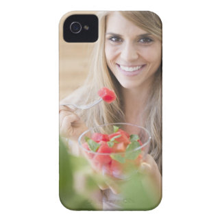 USA, New Jersey, Jersey City, Woman eating Case-Mate iPhone 4 Case