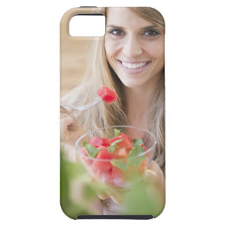 USA, New Jersey, Jersey City, Woman eating iPhone 5 Cases