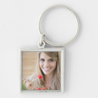 USA, New Jersey, Jersey City, Woman eating Key Ring