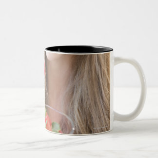 USA, New Jersey, Jersey City, Woman eating Two-Tone Coffee Mug