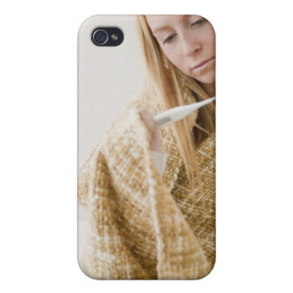 USA, New Jersey, Jersey City, woman wrapped in iPhone 4 Cover