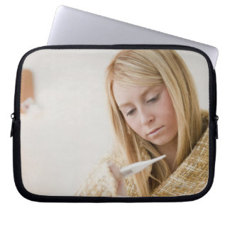 USA, New Jersey, Jersey City, woman wrapped in Laptop Sleeve