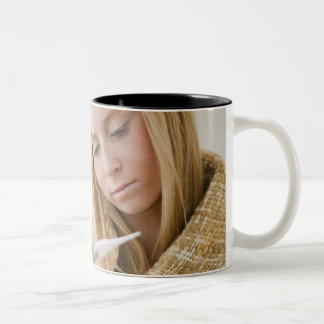 USA, New Jersey, Jersey City, woman wrapped in Two-Tone Coffee Mug